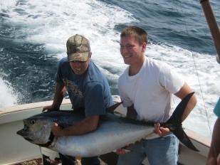 Sore arms make it hard ot heft this bluefin tuna caught aboard Tuna Hunter.